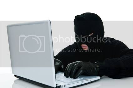 Cyber Attack Masked Criminal at Laptop Computer